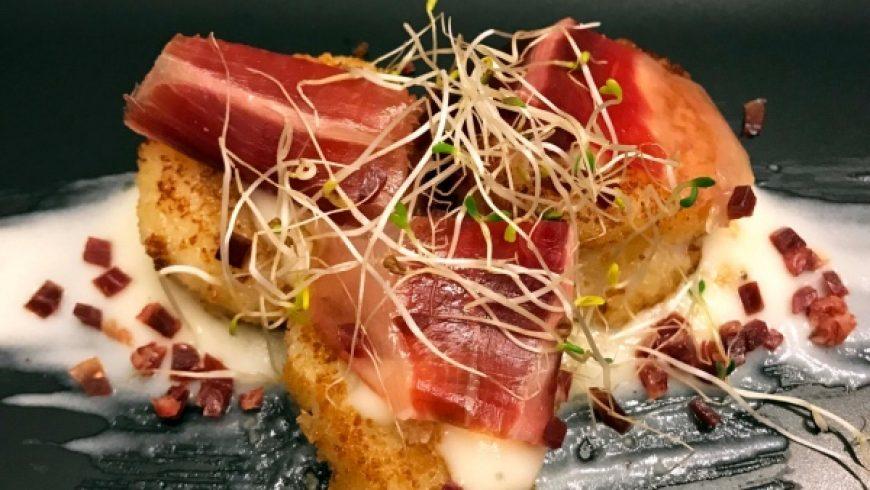 Scallops with Iberico Ham over Potato Cream